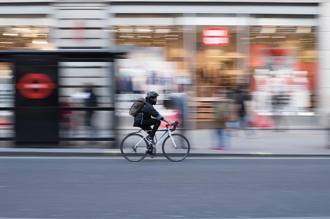 Employee cycling to work